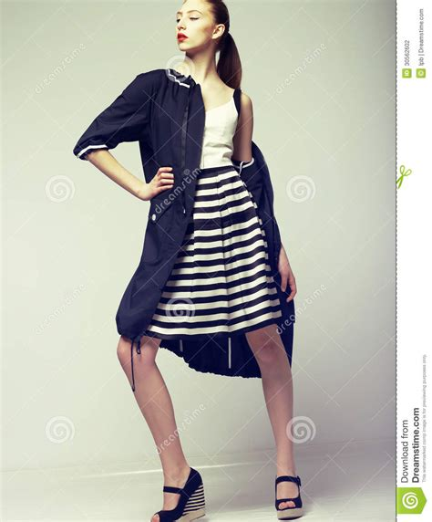 Wardrobe Elegance by Tendency Beautiful Fashion Model In Outwear Elegance