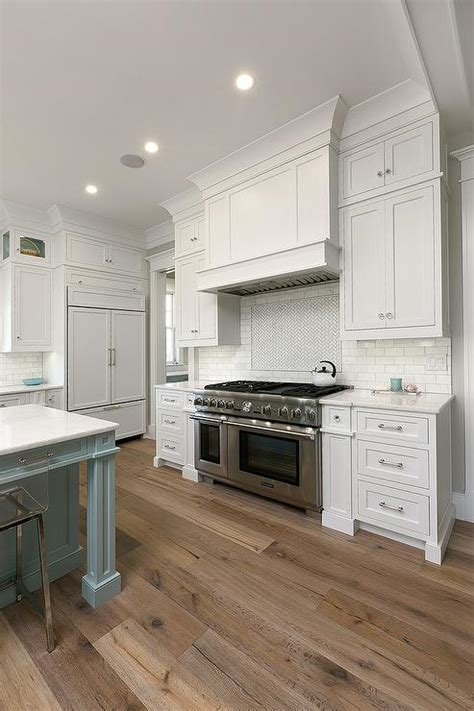 kitchens with wood floors and white cabinets image mag