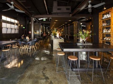 urban coffee shop design code black coffee two melbourne warehouses merge to