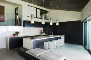 sleek kitchen in black and white with lovely pendant