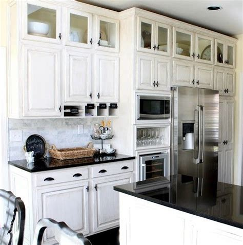adding storage above kitchen cabinets space saver great look add a row of glass front cabinets