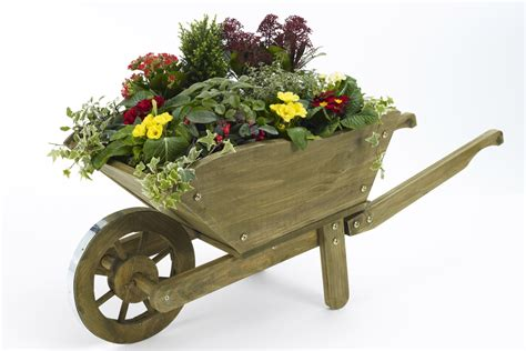 Wooden Wheelbarrow Planter by Wooden Wheelbarrow Planters For Sale Website Of Xiwograd