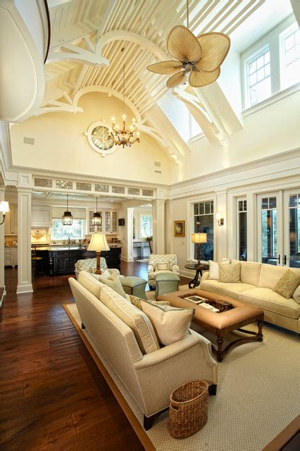 tropical living room with high ceiling ceiling fan in kiawah island club