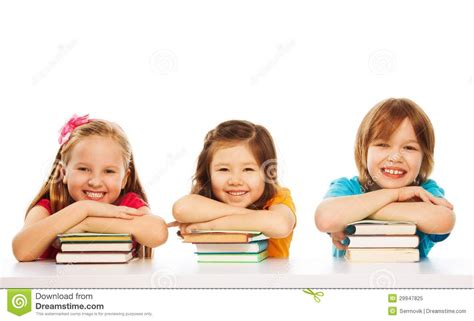 is the smart kid yours books three smart on pile of books royalty free stock photo