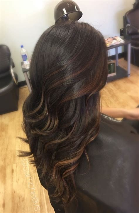 black hair with chocolate brown highlights caramel highlights for dark hair types light brown