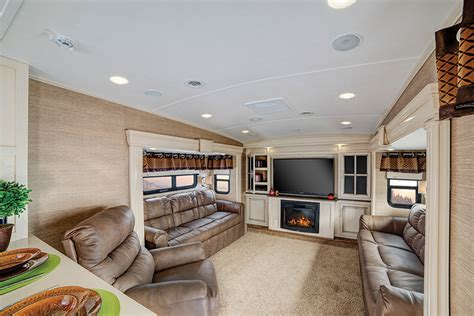 fifth wheel with living room up top the trend in fifth wheels brings the lounge upstairs www trailerlife