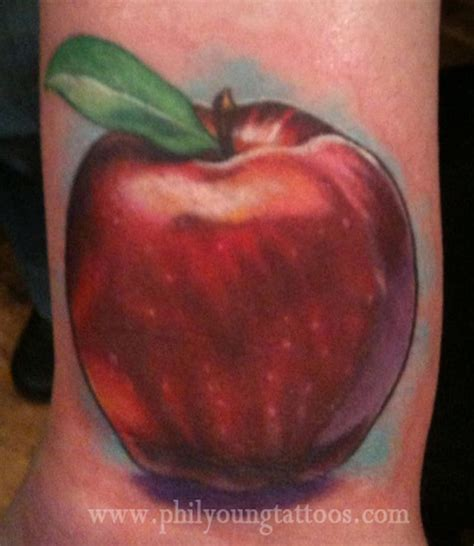 apple tattoo by phil young tattoos