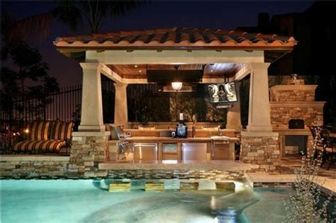 pool and outdoor kitchen designs outdoor kitchens this poolside outdoor kitchen featu