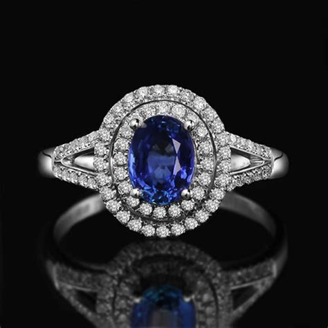 2 carat oval cut blue sapphire and halo engagement