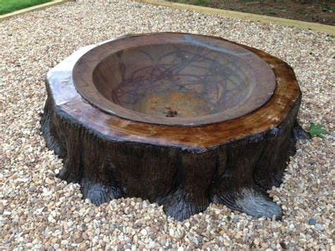 kettle pit cast iron syrup kettle firepit in quot stump quot made of concrete fountains kettle and