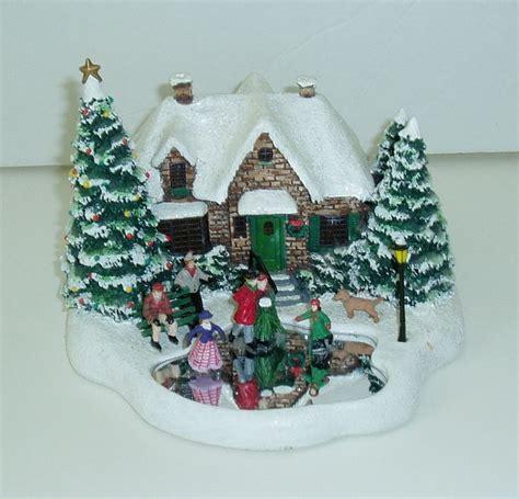 thomas kinkade christmas houses thomas kinkade skaters pond 2004 lighted christmas house figure teleflora gift for