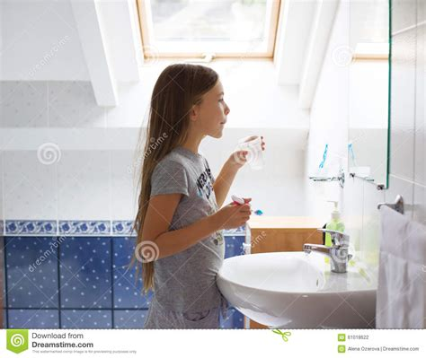 girl in the bathroom girl brushing her teeth stock photo image 61018622