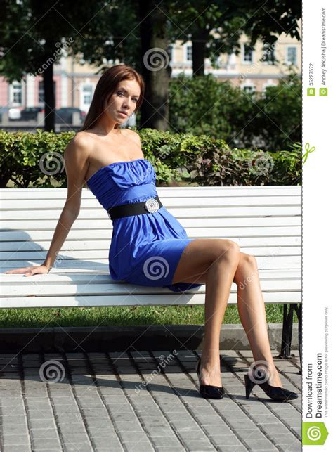 sitting in a park bench young woman sitting on a park bench stock photography image 35227572