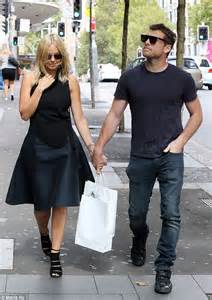 'Newly wed' Lara Bingle works chic asymmetric outfit as she takes a stroll with beau Sam