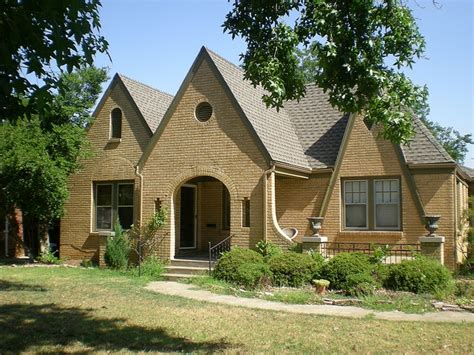 brick bungalow yellow brick gray roof for the home