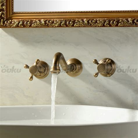 Antique Brass Sink Faucet by Wall Mounted Two Handles Three Holes Antique Brass
