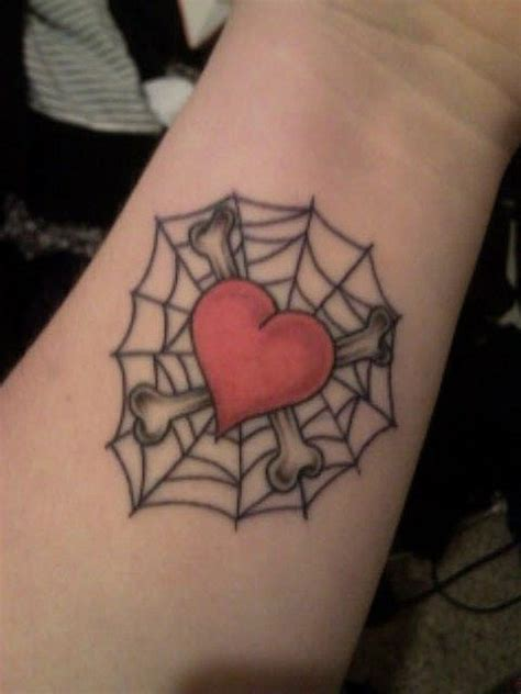 half heart tattoos for couples half spider tattoos for couples