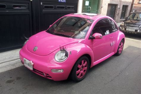 pink volkswagen beetle with eyelashes automobiles cars motor vehicles and road transports