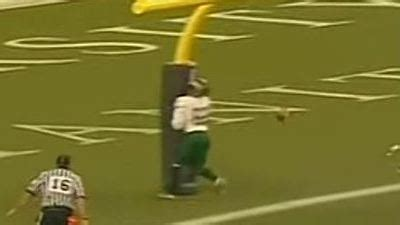 canadian football player crashes into goal post trying for