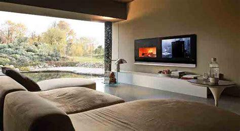 tv su camino biocamino e tv su parete attrezzata