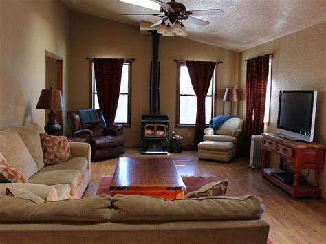 living room with wood burning stove wildwood large family cabin vrbo