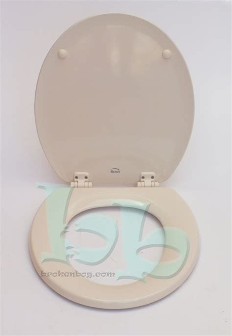 Ideal Standard Shower Baths bemis soft cream toilet seat lid and fittings