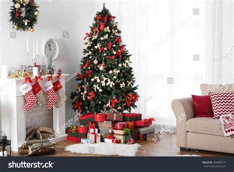 big christmas tree in small room decorated room beautiful fir tree stock photo 504006175