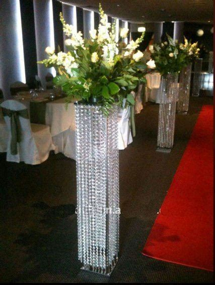 white pillars stands flowers  weddingsfloor standing