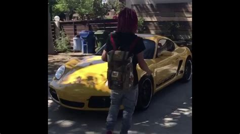 yellow porsche lil lil car