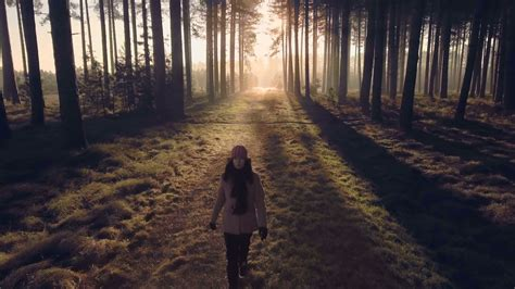 0008288607 the girl in the woods deeper into the woods girl walking into dark forest