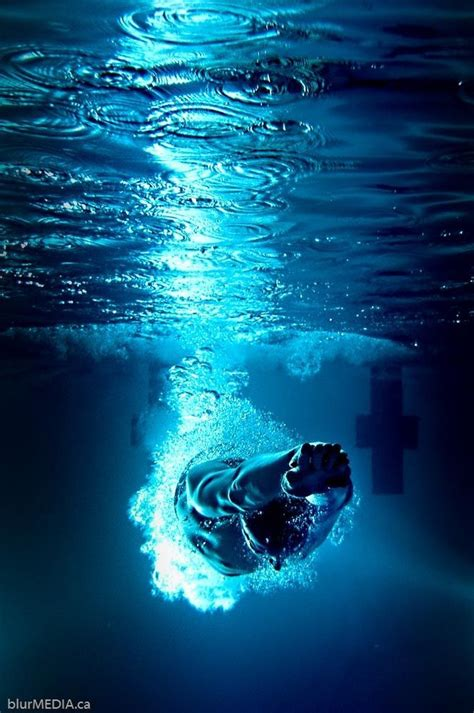 competitive swimmer entry dive underwater