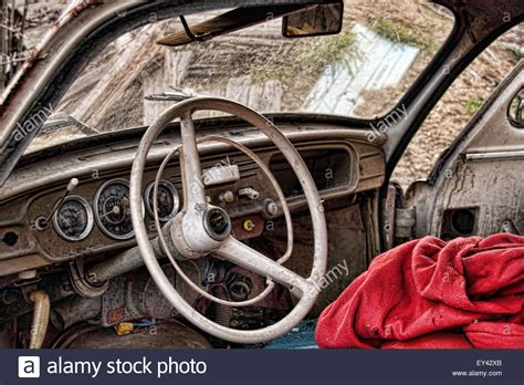 abandoned car in front of my house inside the cabin of an old abandoned rusty skoda parked infront of stock photo