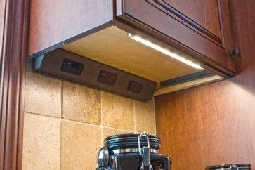 electrical outlet tucked cabinet furniture and