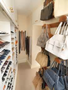 walk in closet with storage for shoes and handbags by tim