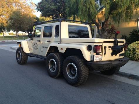 Truck Or Jeep Jeep Wrangler 6x6 Truck Has A Hemi V8 And Guns
