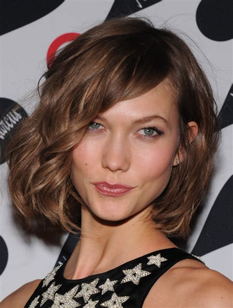 victoria secret model with short hair on the side and the back but long hair on the top karlie kloss chop already named haircut of the year
