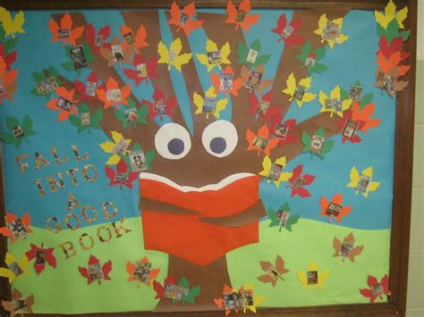 falling into books bullentin board for the hallway at school it says fall