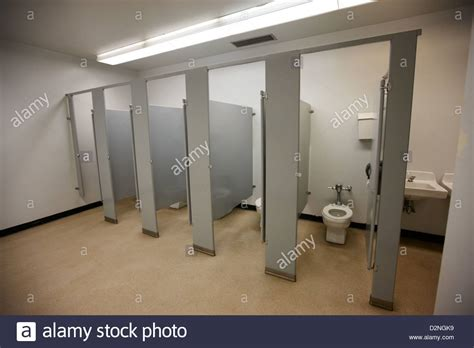 girls bathroom stall cubicle toilet stalls in womens bathroom in a high school canada stock photo royalty
