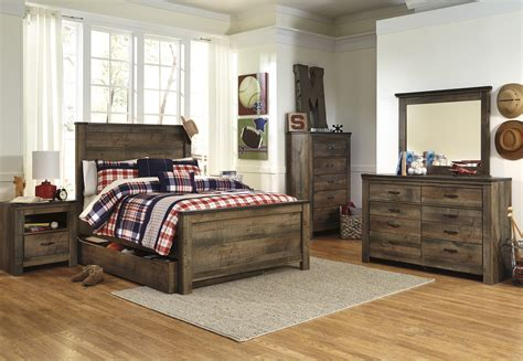 Trinell Bedroom Set by Trinell Panel With Trundle Bernie Phyl S Furniture