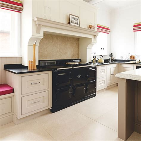 aga kitchen designs neutral kitchen with black aga decorating ideal home