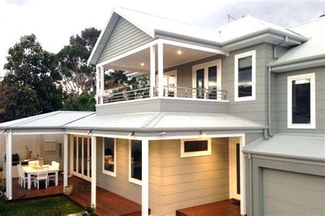 two storey weatherboard house gives a contrast