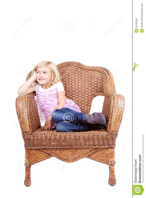 little girl on chair little girl sitting on a chair stock photos image 33731583