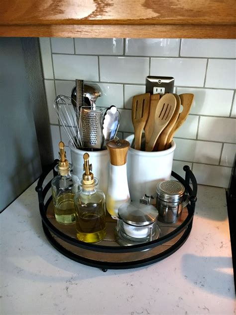 organize kitchen counter organizing the kitchen counter with a tray and canisters