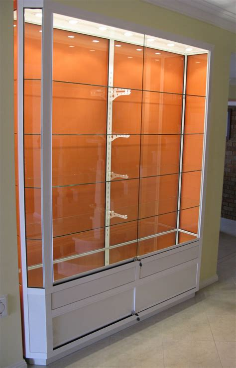 Glass Door Cabinet For Display Contemporary Wall Display Cabinet Feature Clear Glass Material With White Metal Display Cabinet