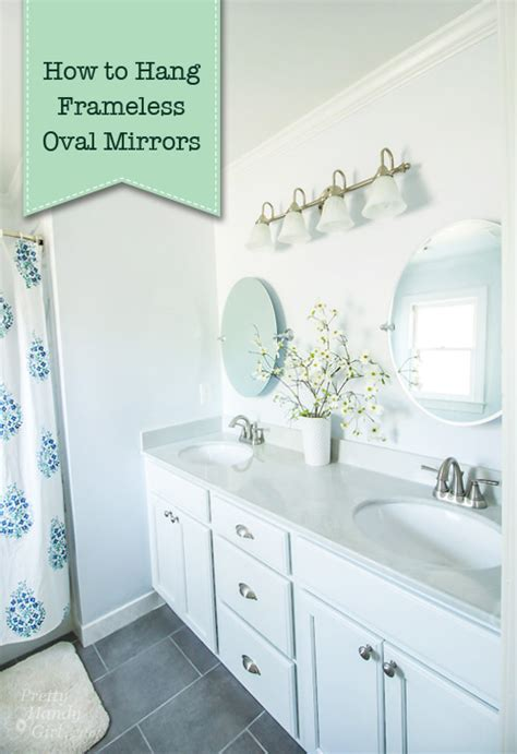 how to hang a bathroom mirror with a frame how to hang a frameless oval mirror pretty handy girl