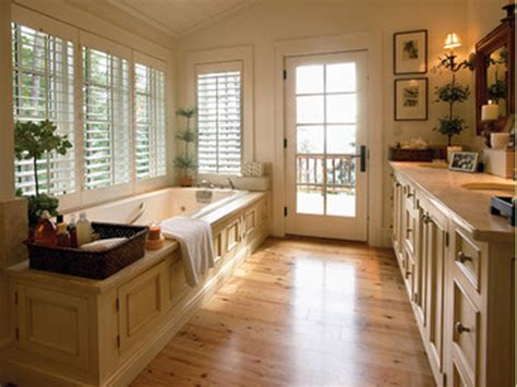 Mr. and Mrs. B: Wood floor in a bathroom!?!