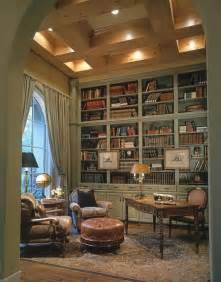 office library blue and cream oriental rug muted green library shelves large arched window wood ceiling