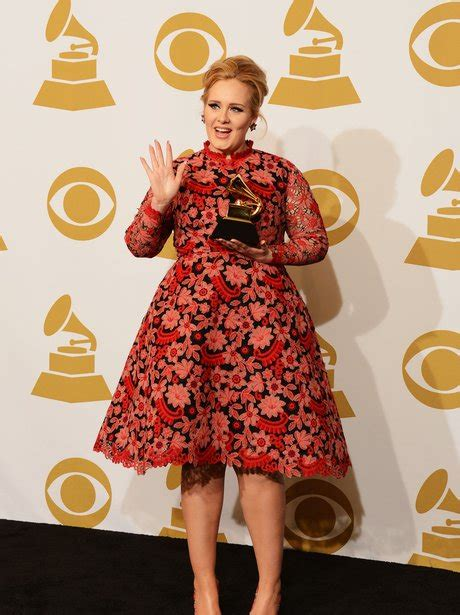 adele grammy photos 2013 adele waves to the cameras as she poses with her new