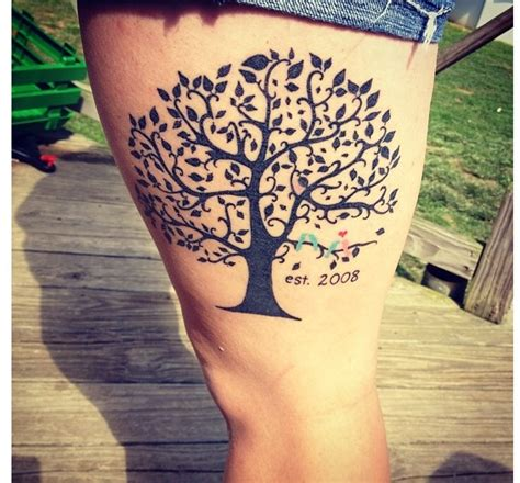 love family smaller on a finger water color mark behind family tree tattoo love the colored birds bucket list
