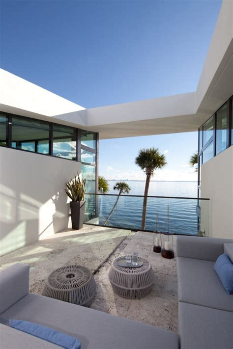 design house studio miami glass front residence on the water in coral gables